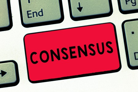 Text sign showing Consensus. Conceptual photo general agreement about particular subject event or action Keyboard key Intention to create computer message, pressing keypad idea