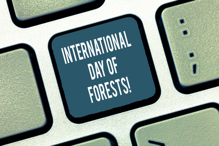 Text sign showing International Day Of Forests. Conceptual photo Natural environment protection celebration Keyboard key Intention to create computer message, pressing keypad idea