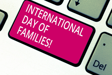Handwriting text International Day Of Families. Concept meaning Family time togetherness celebration Keyboard key Intention to create computer message pressing keypad idea