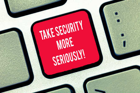Writing note showing Take Security More Seriously. Business photo showcasing Be alert and aware of possible hacking attacks Keyboard Intention to create computer message keypad idea