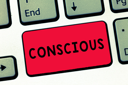 Text sign showing Conscious. Conceptual photo aware of and responding to ones surroundings using his senses Keyboard key Intention to create computer message, pressing keypad idea