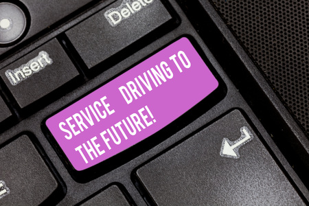 Conceptual hand writing showing Service Driving To The Future. Business photo showcasing Modern technologies assistance services Keyboard key Intention to create computer message idea