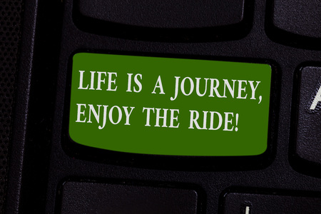 Word writing text Life Is A Journey Enjoy The Ride. Business concept for Enjoying things that happen everyday Keyboard key Intention to create computer message pressing keypad idea