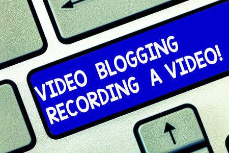 Conceptual hand writing showing Video Blogging Recording A Video. Business photo showcasing Social media networking blogger influence Keyboard key Intention to create computer message idea