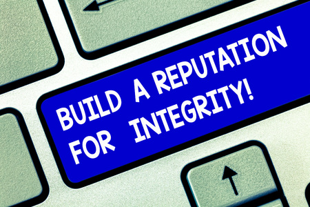 Conceptual hand writing showing Build A Reputation For Integrity. Business photo showcasing Obtain good feedback based on ethics Keyboard key Intention to create computer message idea Archivio Fotografico