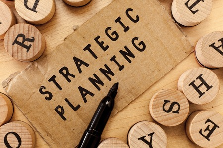 Handwriting text writing Strategic Planning. Concept meaning Organizational Management Activity Operation Priorities.