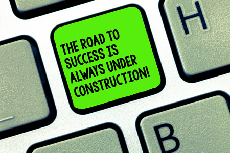 Handwriting text writing The Road To Success Is Always Under Construction. Concept meaning In continuous improvement Keyboard key Intention to create computer message, pressing keypad idea