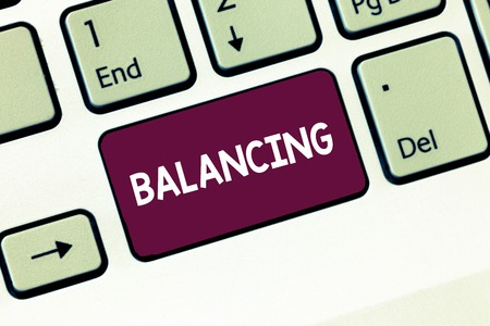 Writing note showing Balancing. Business photo showcasing put something in a steady position so that it does not fall Keyboard Intention to create computer message keypad idea