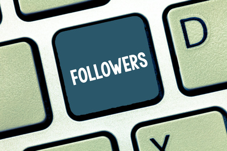 Writing note showing Followers. Business photo showcasing demonstrating who supports and admires particular demonstrating or ideas Keyboard Intention to create computer message keypad idea Stock Photo