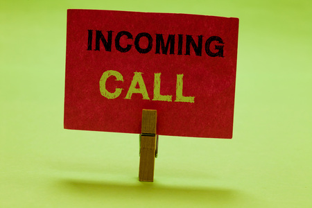 Text sign showing Incoming Call. Conceptual photo Inbound Received Caller ID Telephone Voicemail Vidcall Clothespin holding red paper important communicating messages ideas