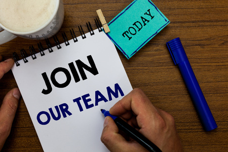 Writing note showing Join Our Team. Business photo showcasing Allied Associate Work with us New Employee Hired Enlist Man holding marker notebook clothespin reminder wooden table coffee Stock fotó