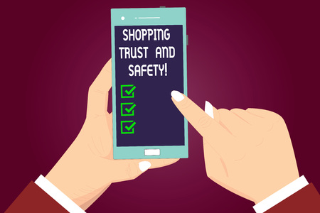 Writing note showing Shopping Trust And Safety. Business photo showcasing Security on online purchase services payments Hu analysis Hands Holding Pointing Smartphone Blank Color Screen 免版税图像