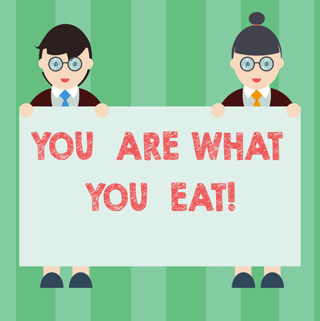 Handwriting text writing You Are What You Eat. Concept meaning Have a healthy lifestyle take care of your foods Male and Female in Uniform Standing Holding Blank Placard Banner Text Space