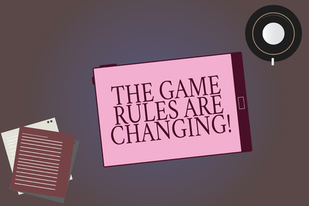 Conceptual hand writing showing The Game Rules Are Changing. Business photo showcasing Changes in established competition agreements Tablet Screen Saucer and Filler Sheets on Color Background Фото со стока