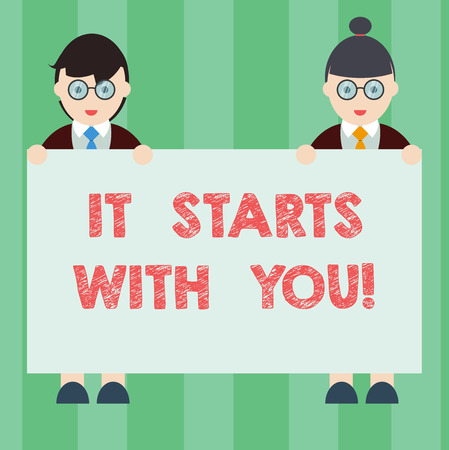 Handwriting text writing It Starts With You. Concept meaning Motivation for starting doing something Have discipline Male and Female in Uniform Standing Holding Blank Placard Banner Text Space Reklamní fotografie