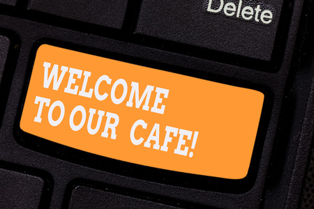 Word writing text Welcome To Our Cafe. Business concept for Greeting receiving showing in restaurant good attention Keyboard key Intention to create computer message pressing keypad idea
