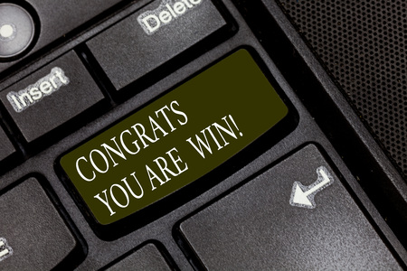 Word writing text Congrats You Are Win. Business concept for Congratulations for your accomplish competition winner Keyboard key Intention to create computer message pressing keypad idea Foto de archivo