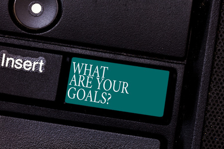 Text sign showing What Are Your Goals. Conceptual photo Tell us your objectives what you want to accomplish Keyboard key Intention to create computer message pressing keypad idea
