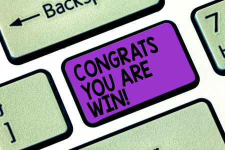 Text sign showing Congrats You Are Win. Conceptual photo Congratulations for your accomplish competition winner Keyboard key Intention to create computer message pressing keypad idea