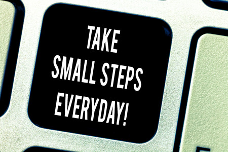 Writing note showing Take Small Steps Everyday. Business photo showcasing Step by step you can reach all your goals Keyboard key Intention to create computer message pressing keypad idea