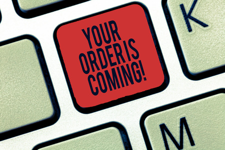 Word writing text Your Order Is Coming. Business concept for Product on the way shipping of purchase products Keyboard key Intention to create computer message, pressing keypad idea Reklamní fotografie