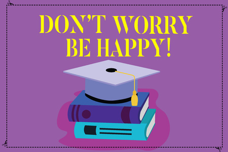 Handwriting text Don T Worry Be Happy. Concept meaning Cheerful be positive relaxed inspired motivated Color Graduation Hat with Tassel 3D Academic cap photo Resting on Books 写真素材