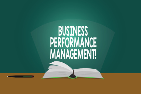 Conceptual hand writing showing Business Perforanalysisce Management. Business photo showcasing setting and monitoring corporate goals Color Pages of Book on Table with Pen and Light Beam Glaring Stock Photo