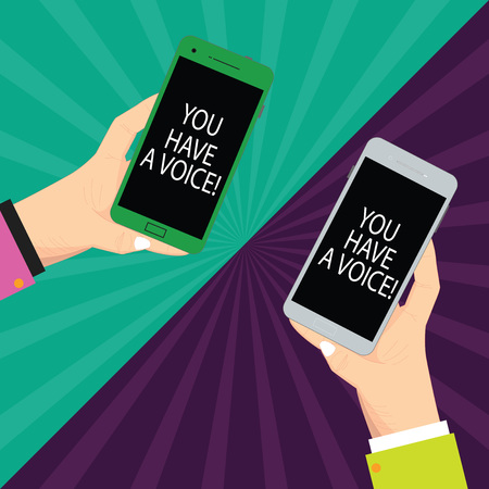 Text sign showing You Have A Voice. Conceptual photo Speak fight for your rights your choices also count Two Hu analysis Hands Each Holding Blank Smartphone Mobile on Sunburst photo