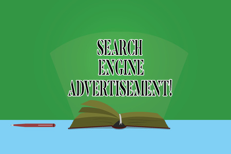 Text sign showing Search Engine Advertisement. Conceptual photo Placing online advertisements on webpages Color Pages of Open Book photo on Table with Pen and Light Beam Glaring