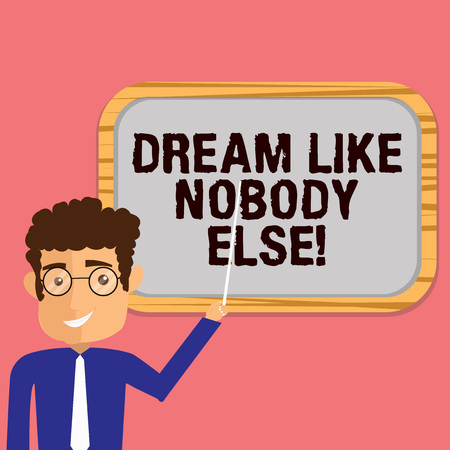Conceptual hand writing showing Dream Like Nobody Else. Business photo showcasing Have mote motivation inspiration than others Man Holding Stick Pointing to Wall Mounted Blank Color Board