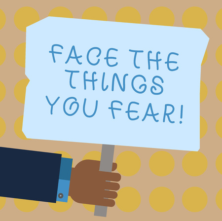 Conceptual hand writing showing Face The Things You Fear. Business photo showcasing Have courage to confront scary situations Hu analysis Holding Colored Placard with Stick Text Space