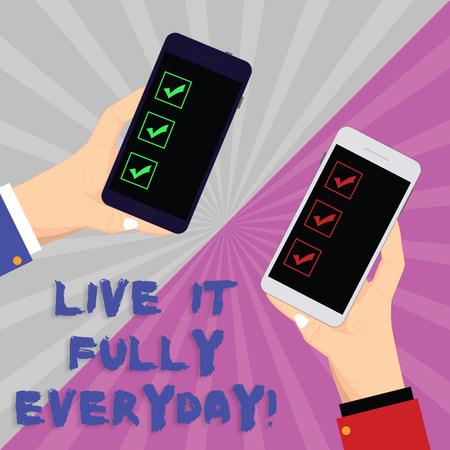 Text sign showing Live It Fully Everyday. Conceptual photo Be optimistic enjoy life Happiness Successful Two Hu analysis Hands Each Holding Blank Smartphone Mobile on Sunburst photo