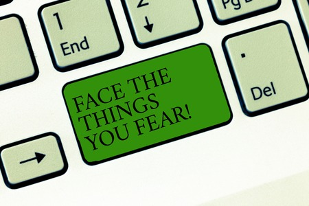 Word writing text Face The Things You Fear. Business concept for Have courage to confront scary situations Keyboard key Intention to create computer message, pressing keypad idea