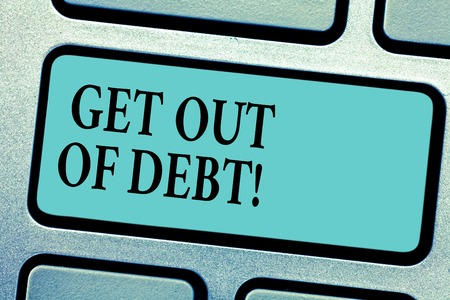 Conceptual hand writing showing Get Out Of Debt. Business photo showcasing No prospect of being paid any more and free from debt Keyboard key Intention to create computer message idea 스톡 콘텐츠