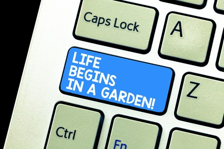 Writing note showing Life Begins In A Garden. Business photo showcasing Agriculture Plants growing loving for gardening Keyboard Intention to create computer message keypad idea Фото со стока