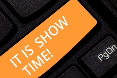 Writing note showing It Is Show Time. Business photo showcasing Entertainment business starting perforanalysisce in stage Keyboard key Intention to create computer message pressing keypad idea