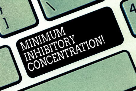 Word writing text Minimum Inhibitory Concentration. Business concept for lowest concentration of a chemical Keyboard key Intention to create computer message pressing keypad idea
