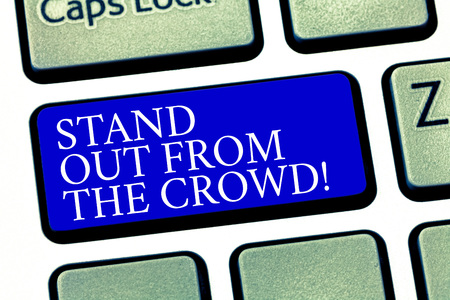 Text sign showing Stand Out From The Crowd. Conceptual photo Be unique different original demonstratingal identity Keyboard key Intention to create computer message pressing keypad idea