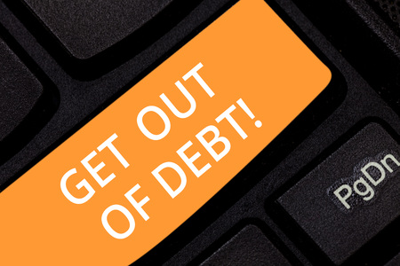 Writing note showing Get Out Of Debt. Business photo showcasing No prospect of being paid any more and free from debt Keyboard key Intention to create computer message pressing keypad idea 스톡 콘텐츠