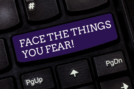 Conceptual hand writing showing Face The Things You Fear. Business photo text Have courage to confront scary situations Keyboard key Intention to create computer message idea Stock Photo