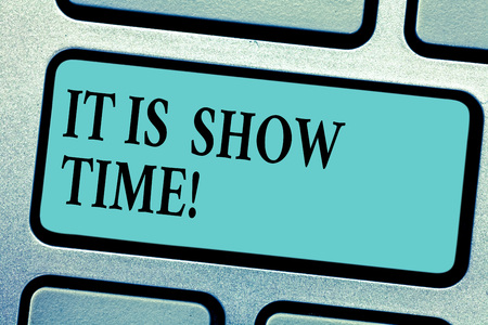 Conceptual hand writing showing It Is Show Time. Business photo showcasing Entertainment business starting perforanalysisce in stage Keyboard key Intention to create computer message idea