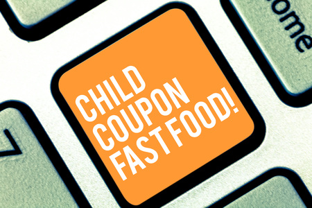 Text sign showing Child Coupon Fast Food. Conceptual photo Ticket discount savings junk meals for kids Keyboard key Intention to create computer message pressing keypad idea Standard-Bild