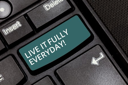 Text sign showing Live It Fully Everyday. Conceptual photo Be optimistic enjoy life Happiness Successful Keyboard key Intention to create computer message pressing keypad idea
