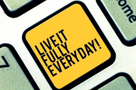 Writing note showing Live It Fully Everyday. Business photo showcasing Be optimistic enjoy life Happiness Successful Keyboard key Intention to create computer message pressing keypad idea Stock Photo