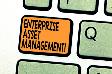 Text sign showing Enterprise Asset Management. Conceptual photo analysisaging the lifecycle of physical assets Keyboard key Intention to create computer message pressing keypad idea Foto de archivo