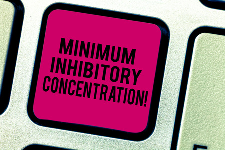 Text sign showing Minimum Inhibitory Concentration. Conceptual photo lowest concentration of a chemical Keyboard key Intention to create computer message pressing keypad idea Banco de Imagens