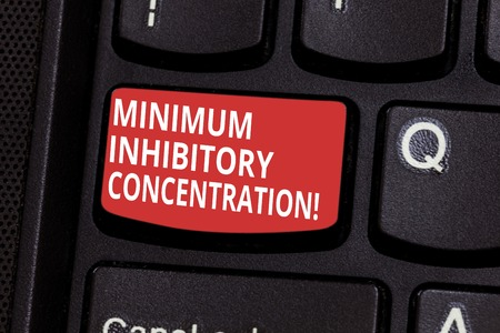 Text sign showing Minimum Inhibitory Concentration. Conceptual photo lowest concentration of a chemical Keyboard key Intention to create computer message pressing keypad idea Imagens