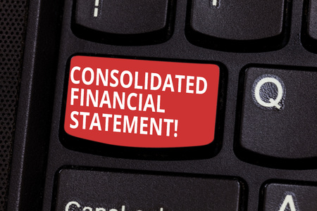 Text sign showing Consolidated Financial Statement. Conceptual photo Total health of a whole group of companies Keyboard key Intention to create computer message pressing keypad idea