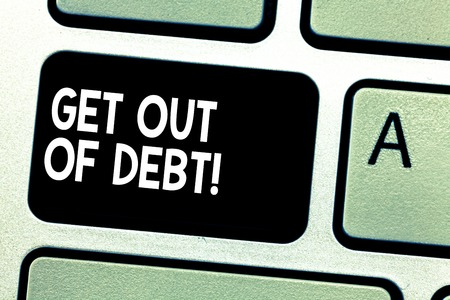 Text sign showing Get Out Of Debt. Conceptual photo No prospect of being paid any more and free from debt Keyboard key Intention to create computer message pressing keypad idea 스톡 콘텐츠