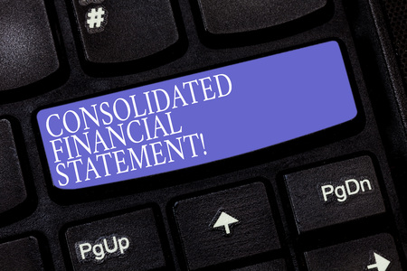 Handwriting text Consolidated Financial Statement. Concept meaning Total health of a whole group of companies Keyboard key Intention to create computer message pressing keypad idea Stock Photo